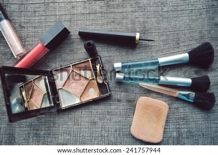 Makeup Eyeliner brush with bottle ,set of cosmetics,Make-up and brushes,powder, puff, mascara, eyeliner  on  wood table - stock photo