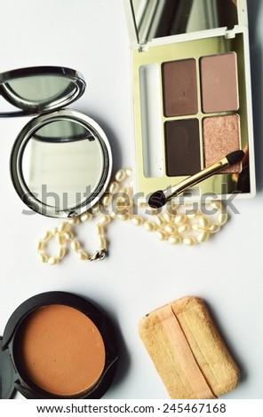 Makeup Eyeliner brush with bottle ,set of cosmetics,Make-up and brushes,powder, puff, mascara, eyeliner on on a white background - stock photo