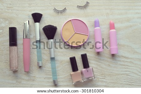Makeup Eyeliner brush with bottle ,set of cosmetics,Make-up and brushes,powder, puff, mascara, eyeliner on wood table,false eyelashes,brush Century
