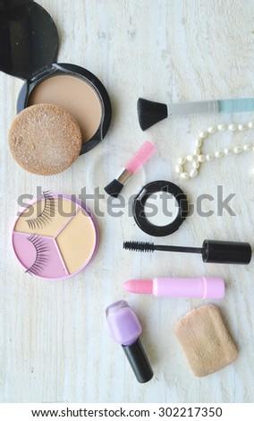 Makeup Eyeliner brush with bottle ,set of cosmetics,Make-up and brushes,powder, puff, mascara, eyeliner on wood table,false eyelashes,brush Century - stock photo
