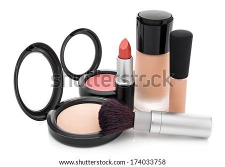 Makeup for natural look. Foundation, concealer, face powder, blush, lipstick, brush. - stock photo