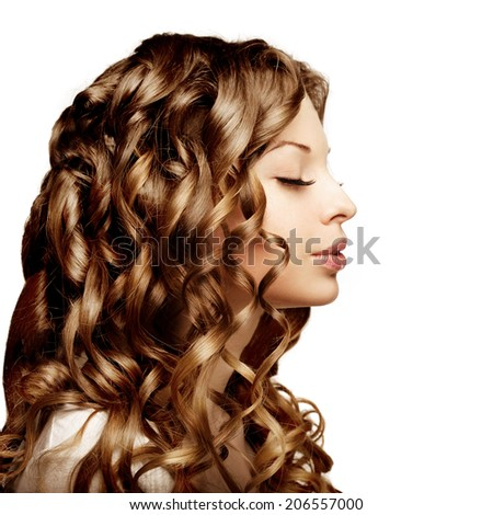 Makeup, hairstyle, curls. Young beautiful woman with luxurious curly hair. Modern stylish trendy girl with curls.