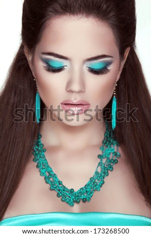Makeup. Jewelry. Glamour Fashion Beauty Woman Portrait. Closeup of girl model - stock photo