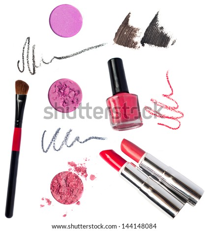 Makeup kit pink eyeshadow, red, terracotta lipsticks, special professional brush for applying, red, black, gray pencil strokes, brown, black mascara sctokes, nail polish bottle. Isolated on white - stock photo