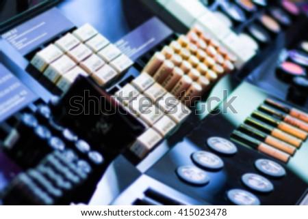 makeup. many cosmetic lip liner, eyeliner, lipsticks, blurred background. - stock photo