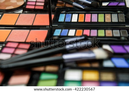 makeup palette and brush, focus on first brush in the mirror