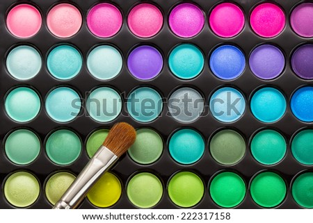 Makeup palette with makeup brush. Makeup background - stock photo