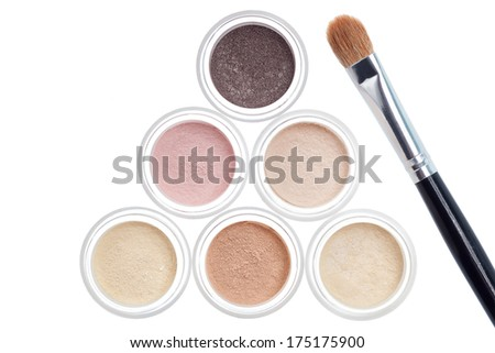 Makeup pastel color set and brush on white background - stock photo