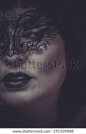 Makeup, portrait of woman with black mask thread Venetian