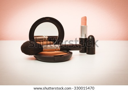 Makeup products on pink background with copy space for your text. Cosmetics and Make-up concept. Studio shot. Horizontal picture - stock photo