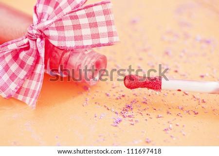 makeup shot of pink lipgloss - stock photo