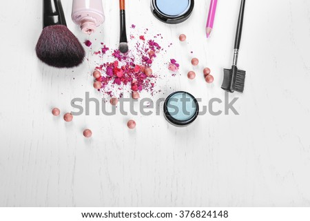 Makeup tools and cosmetics on white background - stock photo