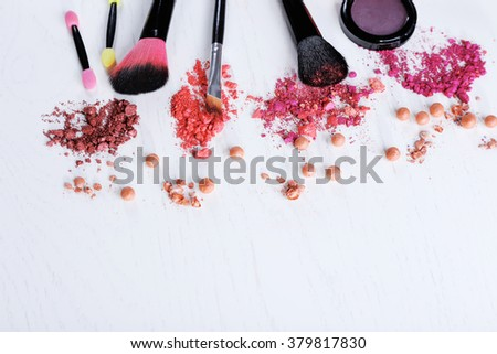 Makeup tools and cosmetics on white background
