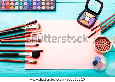 Makeup workplace with copy space on blue wooden background. Top view - stock photo