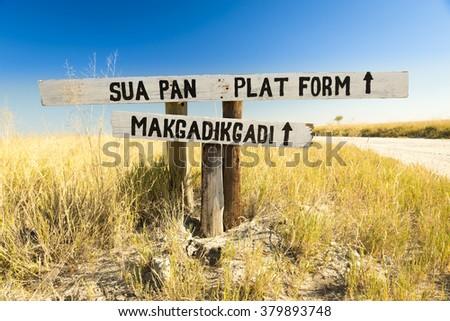 Makgadikgadi Pan sign in Botswana, Africa pointing to the huge salt flats of the Makgadikgadi Pan - stock photo
