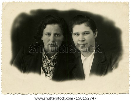 MAKHACHKALA, USSR - CIRCA 1946: Antique photo shows studio portrait of two women, Makhachkala, Dagestan, 1946
