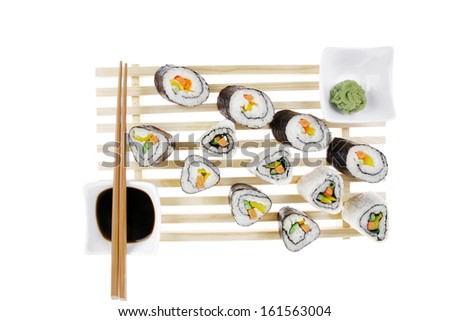 Maki Rolls and California rolls made of fresh raw Salmon, Tuna and Eel with Cream Cheese and Avocado . Isolated over white background . on wooden grid . Maki Sushi and Nigiri - stock photo