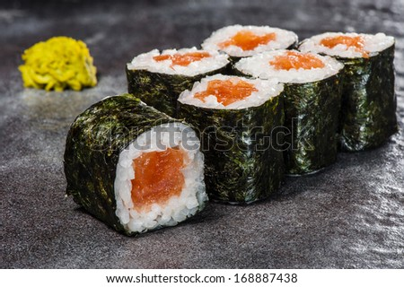 Maki rolls with smoked salmon with wasabi on back front - stock photo