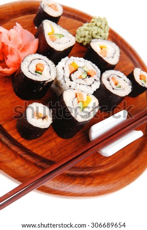 Maki Sushi : Maki Rolls and California rolls made of fresh raw Salmon(sake), Tuna(maguro) and Eel(unagi) . on wooden plate with wasabi and ginger isolated over white background - stock photo