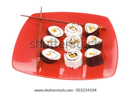 Maki Sushi : Maki Rolls and California rolls made of fresh raw Salmon, Tuna and Eel . on red dish with sticks isolated over white background - stock photo