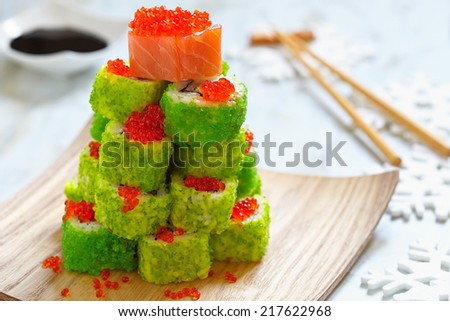Maki Sushi Roll Christmas Tree on a table - stock photo
