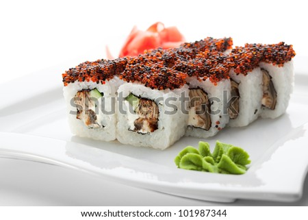 ... Smoked Eel inside. Topped with Red and Black Tobiko (flying fish roe