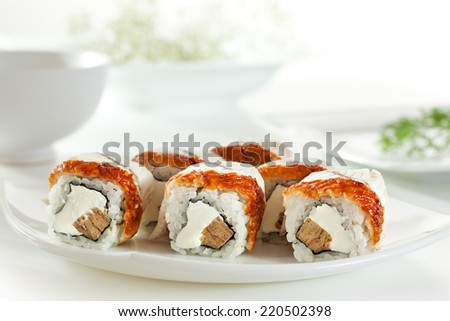 Maki Sushi - Roll made of Japanese Omelet and Cream Cheese  inside. Smoked Eel outside - stock photo