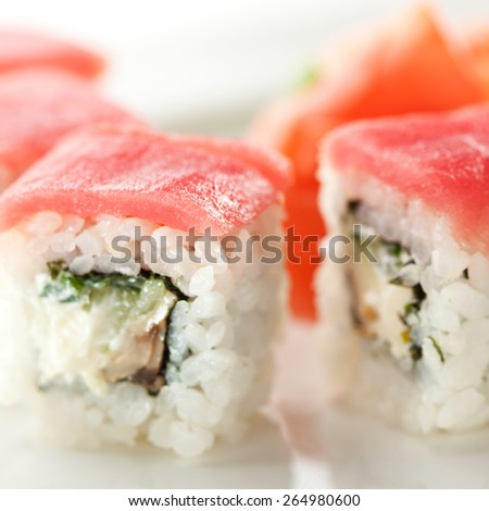 Maki Sushi - Roll with Cucumber and Cream Cheese inside. Topped with Tuna - stock photo
