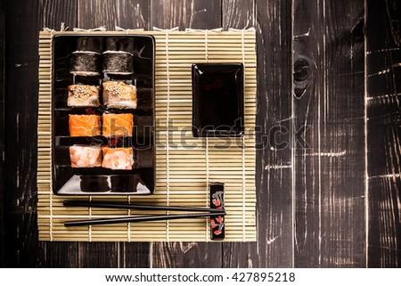 Maki Sushi set on a wooden background - stock photo