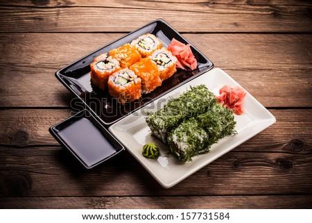 Maki Sushi set on wooden background  - stock photo