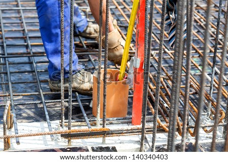 Making a construction with a metal rods, closeup