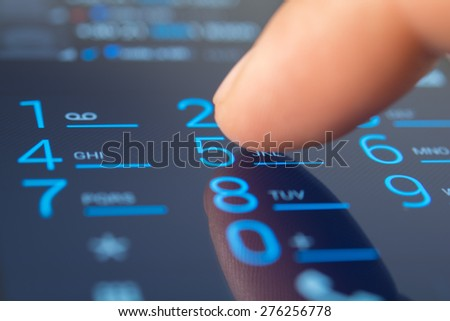 making a dial on a smartphone, close up - stock photo