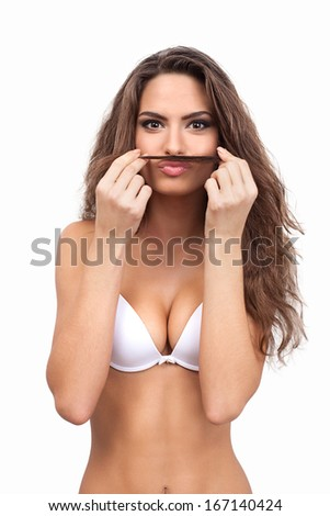 Making a face. Beautiful young woman in white bra making a face while standing against white background
