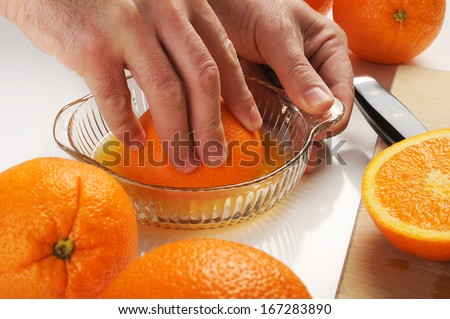 Making a fresh and healthy orange juice - stock photo