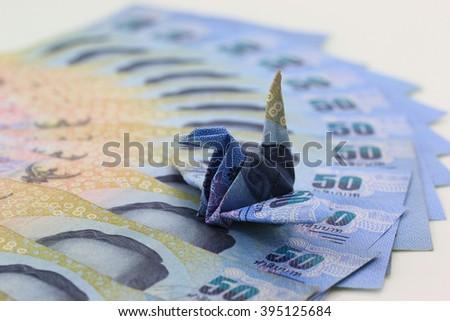 Making a origami bird Thai 50 baht banknotes, Thai money - stock photo