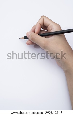 Making A Sketch Close Up Of Woman Hand Holding Black Pencil On White Background