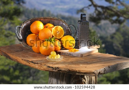 making a traditional greek sweet with orange slices - stock photo
