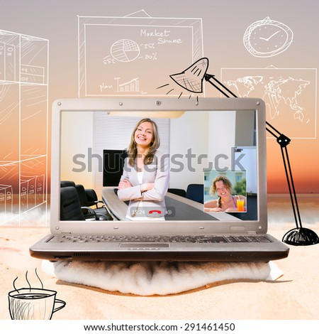 making a video call using laptop on beach at sunrise - stock photo