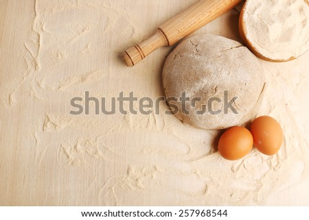 Making bread on wooden table background - stock photo