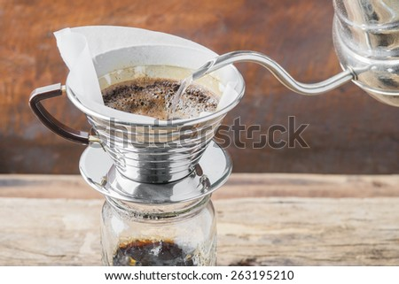 Making brewed arabica coffee from steaming filter drip style. - stock photo