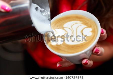 making cappuccino - stock photo