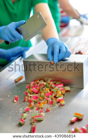Making caramel candies - stock photo