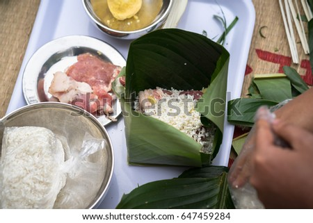 Making Chung cake by hands closeup, Chung cake is the most important traditional Vietnamese lunar New Year (Tet) food.