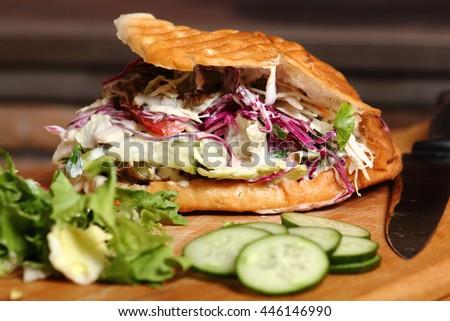 Making Doner kebab in pita - stock photo