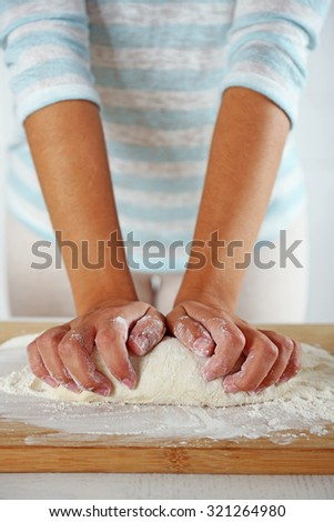 Making dough  for apple pie by female hands at kitchen - stock photo