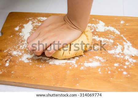 Making dough on cutting board