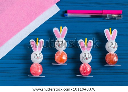 Making easter bunny lollipop sweet gift stock photo royalty free making easter bunny from lollipop sweet gift to children creative idea for childrens party negle Gallery