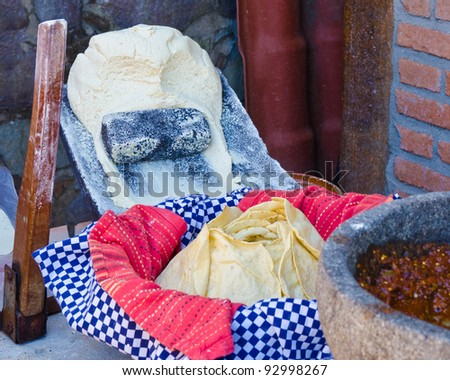 Making flour tortillas. Dough, press and dressing. - stock photo