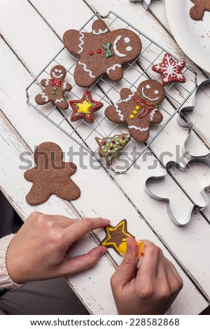 Making gingerbread christmas cookies  - stock photo