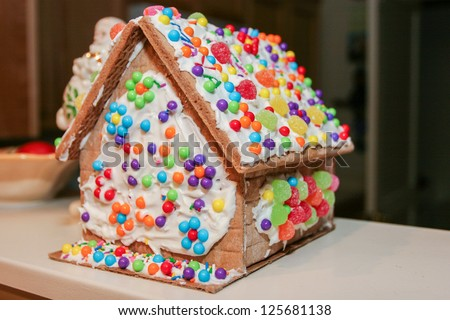 Making gingerbread house together at home before Christmas.